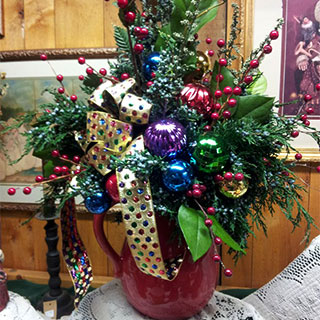 Christmas Decorations and customized real evergreen wreathes and arrangements from Howell's Floral.