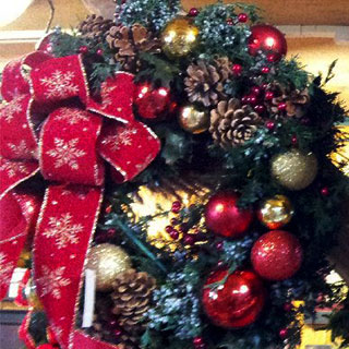 Celebrate the holidays with a decadent Christmas Wreath from Howell's Floral.