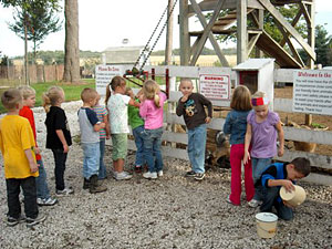 Kids love to see the goats, find pumpkins and explore the farm on school field trips to Howell's Pumpkin Patch in Cummings, Iowa.